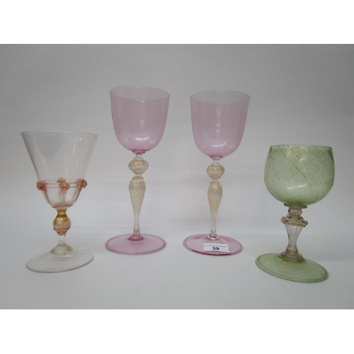 39 - Venetian drinking glasses - a pair of tall wine goblets, pink tinted bowls and feet on knopped stems...