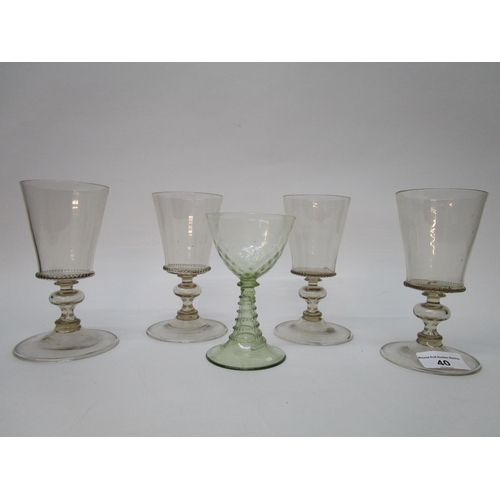 40 - Venetian drinking glasses - a set of four light brown tinted wine glasses, bucket bowls, on knopped,...