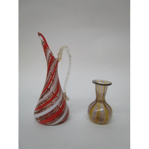 43 - Attributed to Dino Martens for Aureliano Toso Murano, - a mezza filigrana jug, alternating red, aven...