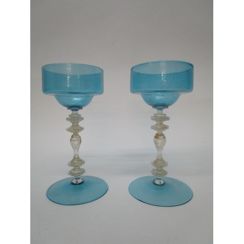 44 - A pair of Venetian wine glasses with sky blue bowls and feet, on fancy knopped clear glass stems, wi...