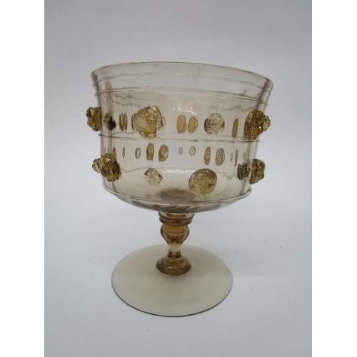 45 - Barovier, Murano - a light brown tinted Venetian goblet decorated with applied strawberry prunts bet...