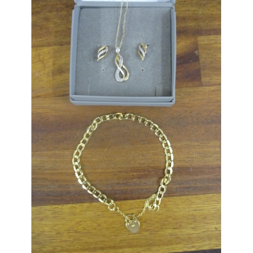 11 - A gold bachelor link bracelet stamped 375, 2.75g, a 9ct gold pendant on a fine chain and a pair of m...