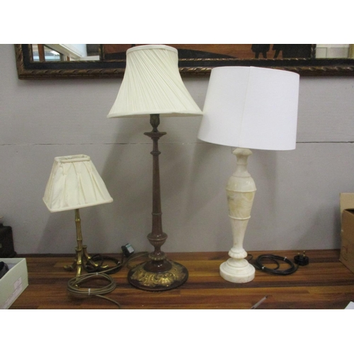15 - Three vintage lamps to include a carved gilt mahogany table lamp with acanthus ornament, an Italian ...