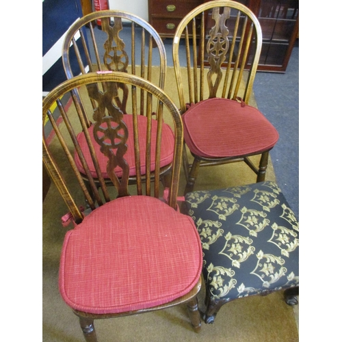 45 - Three early 20th century oak wheel back chairs, together with a mahogany framed footstool...