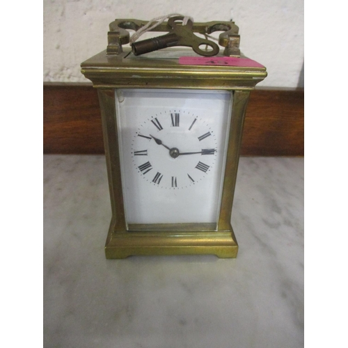 46 - A French brass cased, five window carriage clock with key...