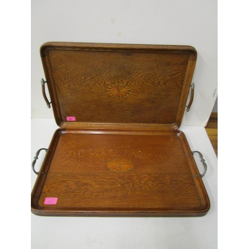 55 - Two early 20th century inlaid oak trays with twin carrying handles...
