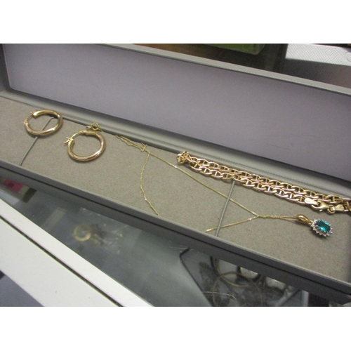 12 - 9ct gold jewellery to include a pair of hoop earrings, and a fine chain 3.9g, and a silver gilt pend...