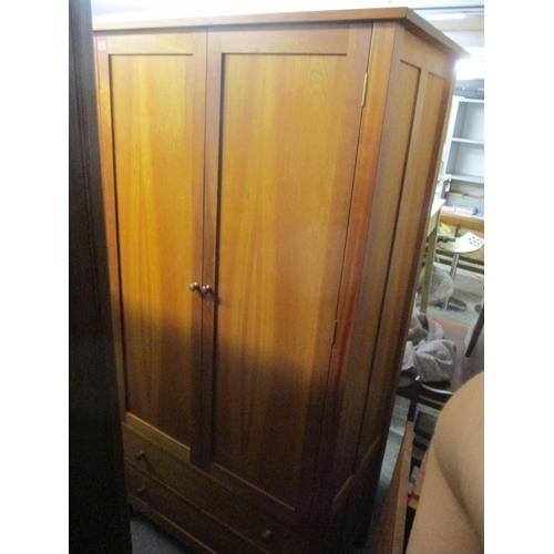 51 - A modern Heals Cherry two door wardrobe with drawers below, 78