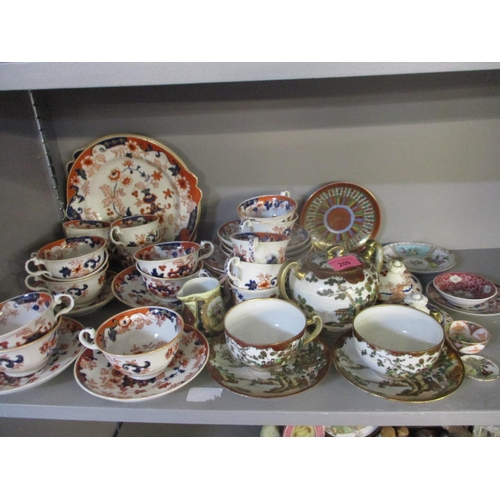 52 - A Noritake sugar bowl with two matching teacups and saucers, and mixed ceramics to include a Japanes...