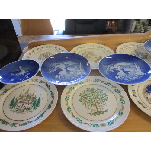 54 - A set of twelve Spode limited edition Christmas plates, together with eight Bing and Grondahl blue p...