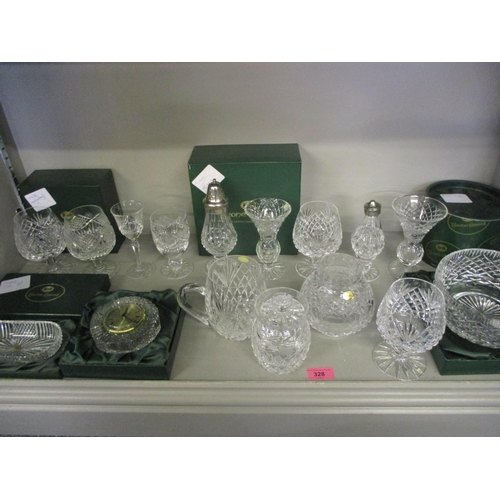 56 - A quantity of Irish Tyrone Crystal to include a mantel clock...