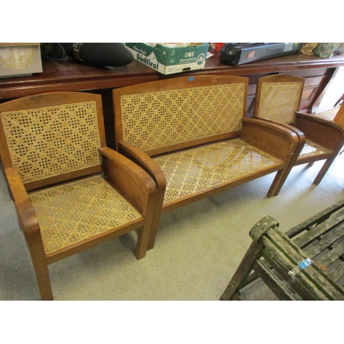 59 - A two seater Colonial can back and seated sofa and two matching armchairs...