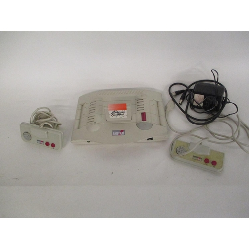 61 - An Amstrad GX4000 game console with hand controllers and Burnin Rubber games...