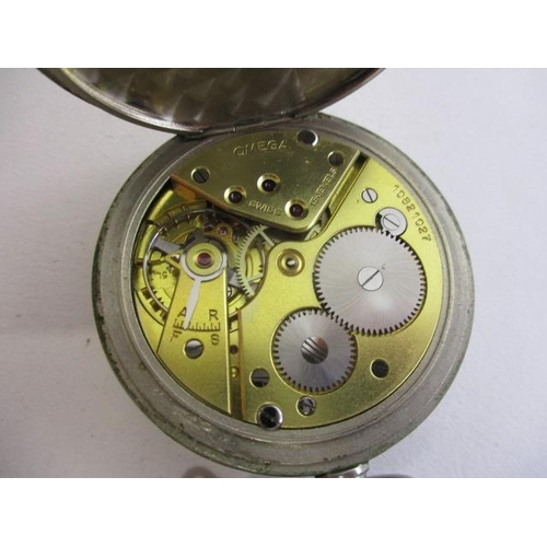 59 - An Omega gents nickel plated, open faced, cased pocket watch having Arabic numerals, subsidiary seco...
