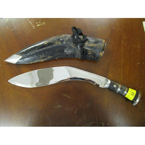 33 - A Kukri in a leather scabbard...