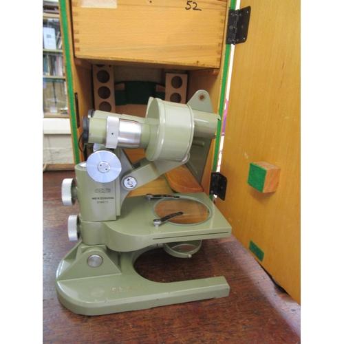 34 - A Minopta SEM 52 Czechoslovakian binocular microscope with additional lens, in a wooden case with ke...