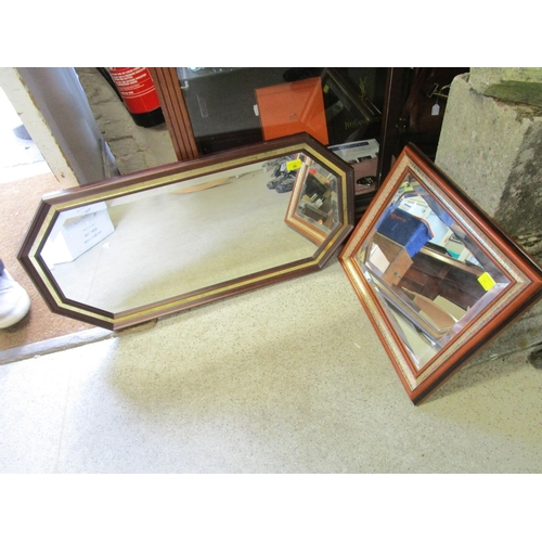 36 - A rectangular eight sided wall mirror with bevelled glass and one other...
