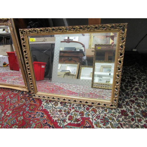 38 - A square shaped wall mirror with scrolled leaf, gilt frame...