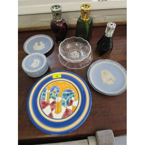 39 - A lot of ceramics and glassware to include three lamps Berger, a Val St Lambert signed bowl and stan...