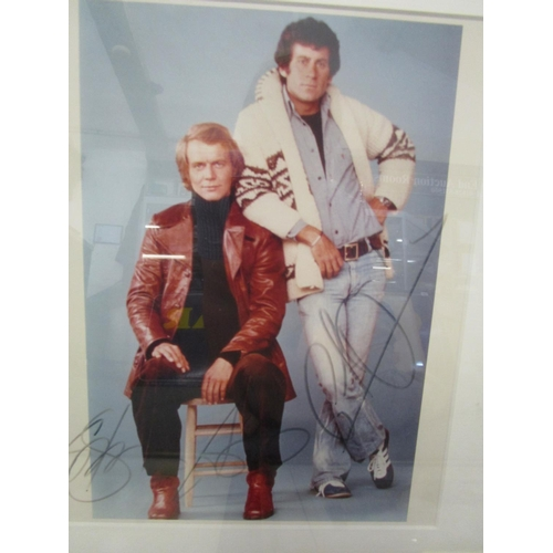 41 - A group of prints, photographs and others to include a signed Starsky and Hutch photograph, all moun...