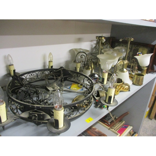 4 - A mixed lot to include a wrought iron chandelier, mixed lights, brassware and a wall clock...
