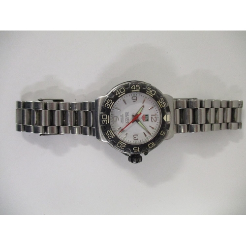 15 - A gents Tag Heuer Formula One, stainless steel cased wristwatch with integral bracelet, three jewell...