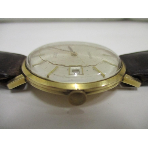 16 - A gents Ermano, 14k gold cased wristwatch with 17 jewel Swiss made Incabloc movement, having a date ...