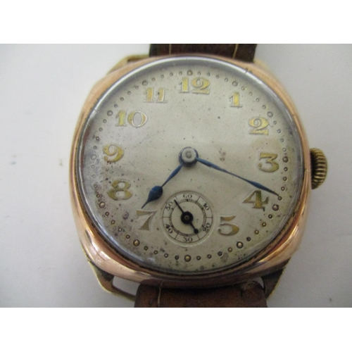17 - A gents 9k gold cased vintage wristwatch with 15 jewelled Swiss movement, having a silvered dial wit...