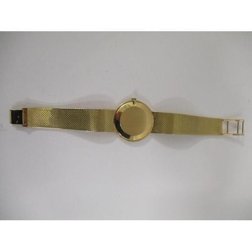 19 - A gents Jaeger Le Coultre 18ct gold bracelet wristwatch having a black dial with gold Roman numerals...