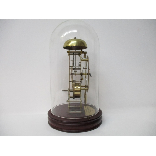 2 - A 20th century brass skeleton clock having a silvered dial, Roman numerals and plastic dome, the mov...