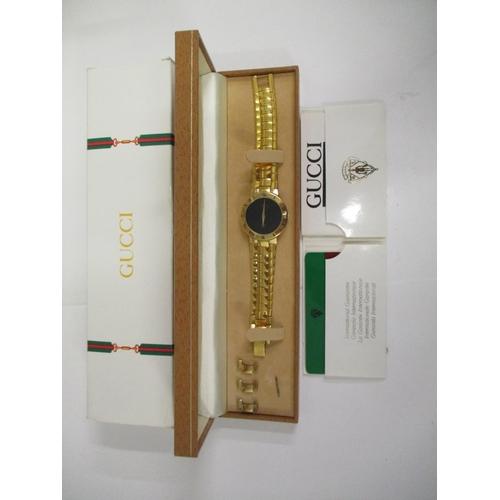 21 - A gents Gucci 3000m, gold plated bracelet wristwatch, Swiss made 6 jewelled, quartz operated movemen...