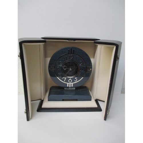 3 - An Alfred Dunhill Art Deco style chrome and laminated wood table clock in a presentation case, 10