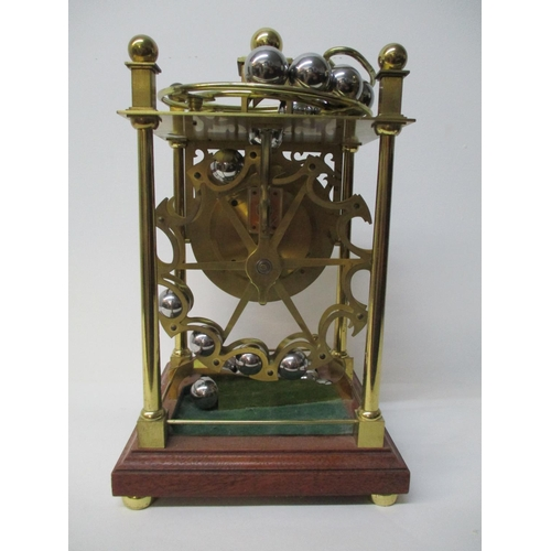 5 - A 20th century spherical rolling ball table clock, manufactured by Harding Bazeley, Cheltenham, Engl...