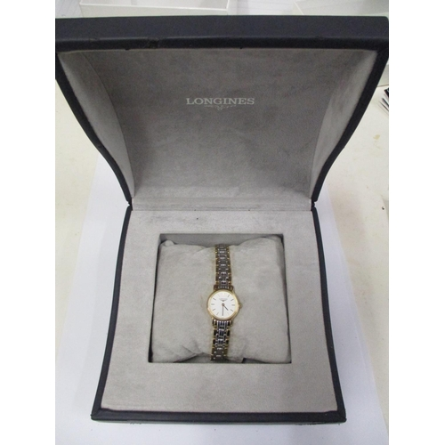 57 - A ladies' quartz gold plated bi-colour bracelet watch having a champagne dial with baton markers, co...