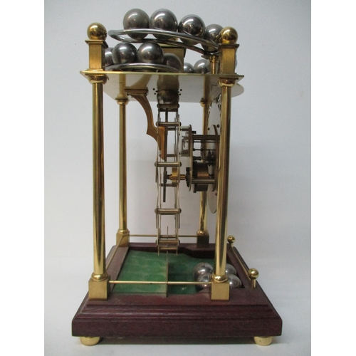 6 - A 20th century spherical rolling ball table clock, manufactured by Dove Baxeley, Cheltenham, England...