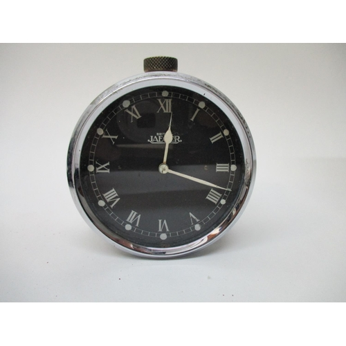 63 - A Jaeger vintage car clock converted to a bedside clock, having a black dial with Roman numerals and...