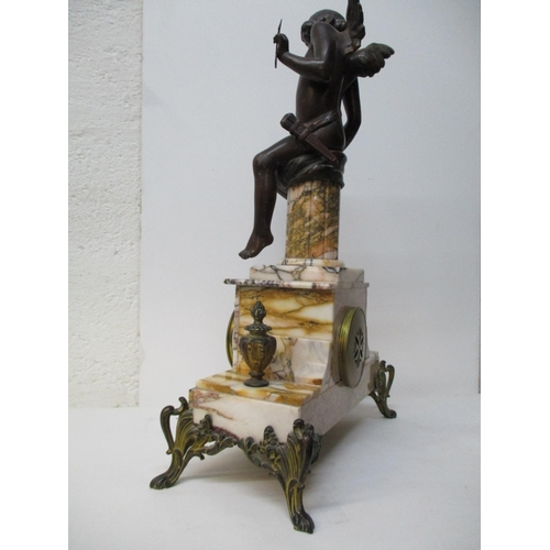 8 - A late 19th century French bronze and spelter marble clock with garniture, 8 day movement striking o...