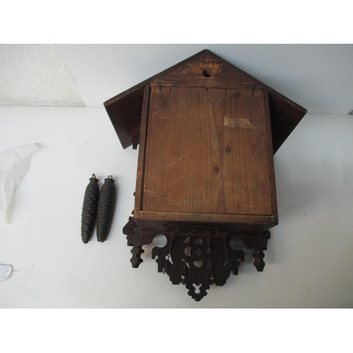 9 - An early 20th century two weight, Black Forest oak cuckoo clock, chalet case with carved decoration,...