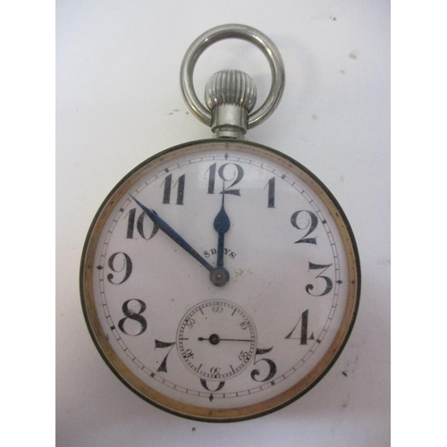 45 - An early 20th century nickel cased, keyless wind, 8 day Goliath watch having a white enamel dial, Ar...