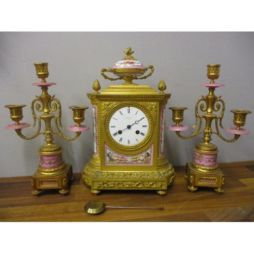 52 - A late 19th century French gilt metal and porcelain clock garniture, retailed by Kalgtenberger 157 R...