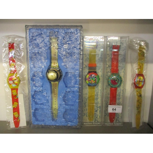 64 - Two cased Swatch Scuba 200 wristwatches, together with two Wesco Simpson watches and a Happy Holiday...