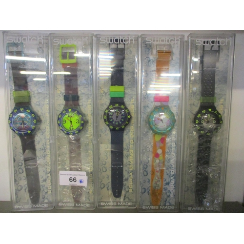 66 - Five cased Swatch scuba 200 wrist watches and a set of Timezone loops...