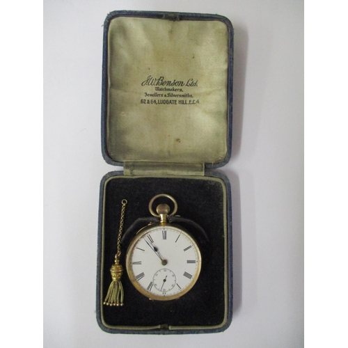 39 - An 18k gold cased pocket watch with a gold coloured fob tassel and white enamel dial, having Roman n...