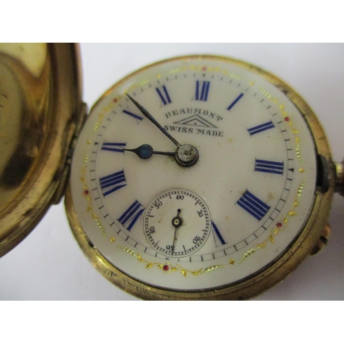 43 - A ladies' 18k gold cased, engraved, manual wind fob watch, having a champagne dial, blue Roman numer...