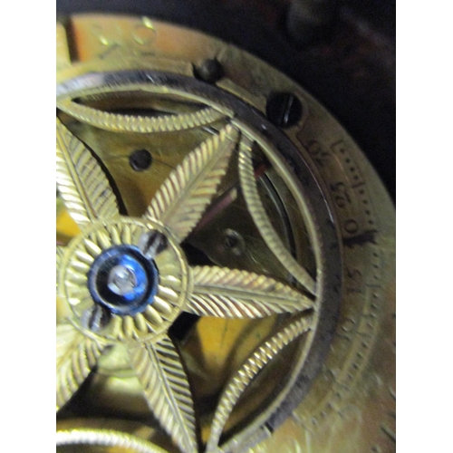 44 - An early 19th century brass bound, oak circular Sedan clock, the 4