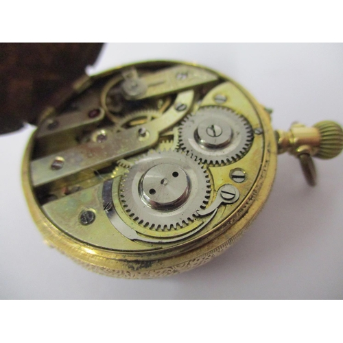 70 - A ladies 14ct gold engraved cased fob watch having a lever movement, decorated Champagne coloured di...