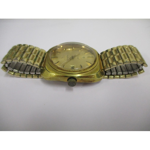 74 - A Tissot Sea Star automatic gents wristwatch, having a gold plated case, gold coloured dial with hou...