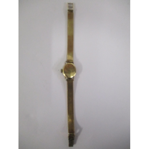 77 - A ladies Audax 9ct gold watch fitted with a 9ct gold bracelet having a Champagne coloured dial with ...