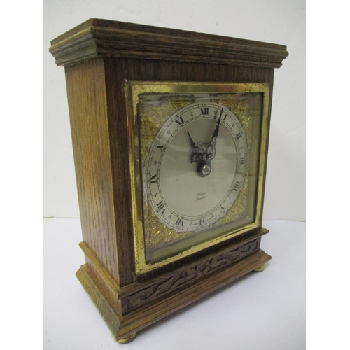 41 - An Elliott of London oak eight day mantle clock, retailed by Aspreys, having a square silvered dial,...