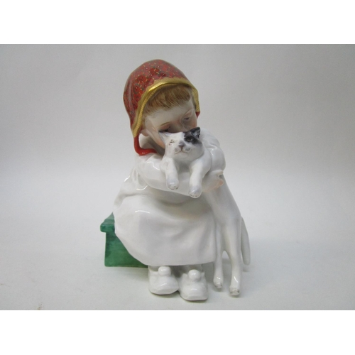 174 - A Meissen Art Nouveau Konrad Hentschel figure of a girl sat on a green box, with a cat in her arms, ...